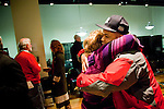 Lorinda Arella (L), of VETFAMSA; hugs Mike Martinez (R), an Army sergeant in the Iraq war who became a NYPD police officer; after the Veteran-Civilian Dialogue at Intersections International on February 4, 2011 in New York City.  (PHOTOGRAPH BY MICHAEL NAGLE)