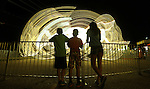"From left Matthew Colcas, 10, Darrius Higgins, 9, and Nyira Williams, 14, watch the 'Spider"" amusement ride at the Cheyenne Frontier Days carnival Monday night. Michael Smith/staff"