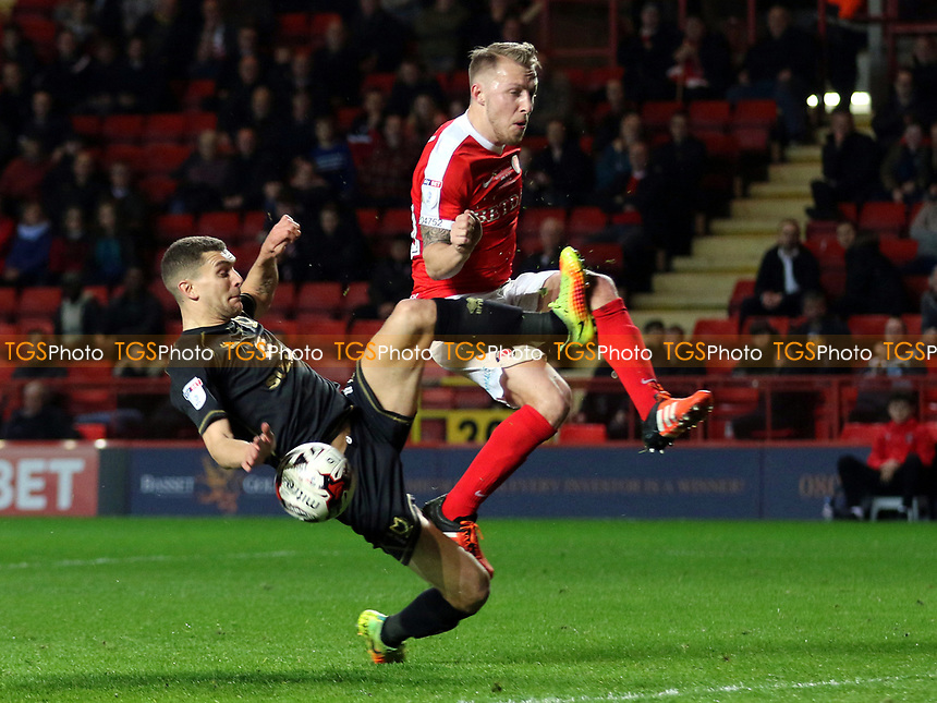 Stuart O'Keefe of MK Dons mistimes a challenge on Charlton's Chris Solly during Charlton Athletic vs MK Dons, Sky Bet EFL League 1 Football at The Valley on 4th April 2017