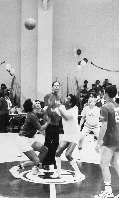 Sen. Chuck Schumer, D-N.Y., Sen. Thomas Downey, D-N.Y., Dean Everett Bellamy and Sen. Bill Bradley, D-N.J. at the basketball court. March, 1988. (Photo by CQ Roll Call)