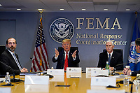 United States President Donald J. Trump speaks during a teleconference with governors at the Federal Emergency Management Agency headquarters, Thursday, March 19, 2020, in Washington, DC. From left, US Secretary of Health and Human Services (HHS) Alex Azar, Trump, and US Vice President Mike Pence. <br /> Credit: Evan Vucci / Pool via CNP/AdMedia