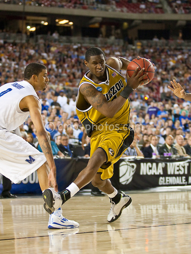 Mar 26, 2009; Glendale, AZ, USA; Missouri Tigers guard J.T. Tiller (4) picks up his dribble in front of Memphis Tigers forward Shawn Taggart (0) in the first half of a game in the semifinals of the west region of the 2009 NCAA basketball tournament at University of Phoenix Stadium.    Missouri defeated Memphis 102-91.
