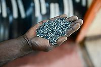RWANDA, Kigali, plastic recycling at company ecoplastics, recycled granules which is used for new plastic products / RUANDA, Kigali, plastic recycling bei Firma Ecoplastics, Herstellung von Kunststoff Granulat aus alten Folien zur Wiederverwendung für neue Folien