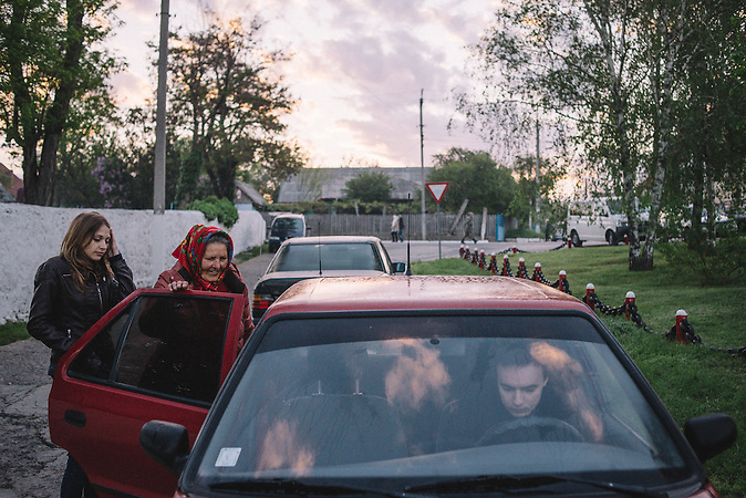 Alexander, Katrine and her grandmother getting back home after Easter morning. Ribnita, Transnistria