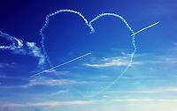 The Red Arrows create a heart shape as they perform for the Air Show in Swansea Bay, Wales, UK. Sunday 02 July 2017