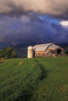 Vermont, VT, Storm clouds over the Green Mountains and Bragg Farm in Fayston.