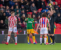 12th February 2020; Bet365 Stadium, Stoke, Staffordshire, England; English Championship Football, Stoke City versus Preston North End; Joe Allen of Stoke City receives a yellow card - Strictly Editorial Use Only. No use with unauthorized audio, video, data, fixture lists, club/league logos or 'live' services. Online in-match use limited to 120 images, no video emulation. No use in betting, games or single club/league/player publications