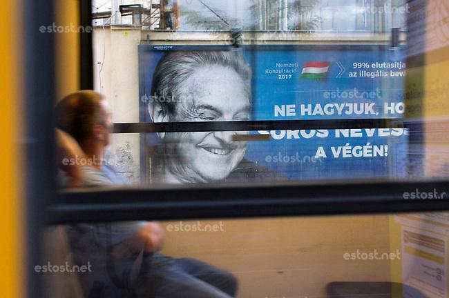 UNGARN, 07.2017, Budapest - VIII. Bezirk. Kampagne der Fidesz-Regierung gegen den US-ungarischen Juden, Finanzspekulanten und Foerderer einer offenen Gesellschaft, George Soros: &quot;Lassen wir nicht zu, dass Soros als Letzter lacht!&quot; Darueber in klein: &quot;99% (der Teilnehmer der Propaganda-Volksbefragung &quot;Nationale Konsultation&quot;) lehnen die illegale Einwanderung ab.&quot;    Fidesz government campaign against the US-Hungarian jew, financial speculator and supporter of an open society, George Soros: &quot;Let's not Soros have the last laugh!&quot;. Small letters: &quot;99% (of the participants of the propaganda-referendum called &quot;national consultation&quot;) oppose illegal immigration.&quot;  <br /> &copy; Martin Fejer/estost.net