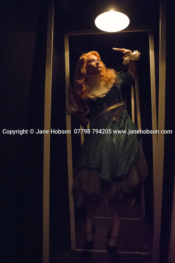 London, UK. 14.04.2015. Alice's Adventures Underground – UK premiere of a new grand scale immersive theatre production by acclaimed theatre company Les Enfants Terribles and Emma Brünjes Productions. Picture shows: Alice (Abby Wain). Photograph © Jane Hobson.