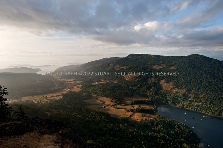 8/25/2009--Salt Spring Island, British Columbia, Canada..The sunrise view of the Gulf Islands, with Vancouver Island in the distance, from the top of Mt. Maxwell on Salt Spring Island...©2009 Stuart Isett. All rights reserved.