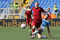 Calcio, Serie A: Lazio vs Roma. Roma, stadio Olimpico, 3 aprile 2016.<br /> Roma's Radja Nainggolan, left, is tackled by Lazio's Marco Parolo during the Italian Serie A football match between Lazio and Roma at Rome's Olympic stadium, 3 April 2016.<br /> UPDATE IMAGES PRESS/Riccardo De Luca
