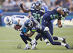 Tennessee Titans' wide receiver Marcus Harris is brought down by Seattle Seahawks' corner back Richard Sherman in a pre-season game  at CenturyLink Field in Seattle, Washington on August 11, 2012. ©2012. Jim Bryant Photo. All Rights Reserved...