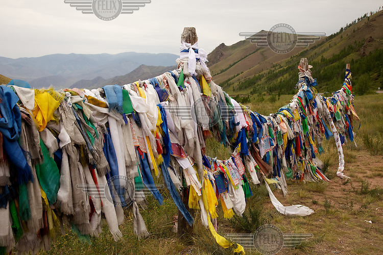 Prayer flags wave in the wind on a road to Kyzyl, capital of Tuva Republic, southern Siberia, Russia. Isolated from air and train transport, the population of Tuva retains a strong sense of traditional spiritual culture.