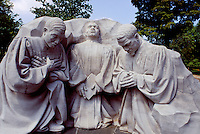 """Ministers kneeling in prayer, by Raymond Kaskey, is at """"""""Revolution and Reconciliation Park"""""""", which has many monuments to the civil rights movement. Birmingham,  Alabama"""