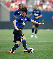 Manchester United midfielder Ji-Sung Park (13) makes a move with the ball.  Manchester United defeated the Chicago Fire 3-1 at Soldier Field in Chicago, IL on July 23, 2011.