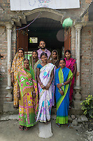 Chanda Devi (centre), 30, the Director of a Producer Company with over 1900 members, poses for a group portrait with her other board of directors at their company building in Muzaffarpur, Bihar, India on October 27th, 2016. Non-profit organisation Technoserve works with women vegetable farmers in Muzaffarpur, providing technical support in forward linkage, streamlining their business models and linking them directly to an international market through Electronic Trading Platforms. Photograph by Suzanne Lee for Technoserve