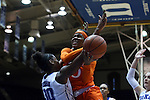 18 January 2015: Miami's Michelle Woods (right) is fouled by Duke's Amber Henson (30). The Duke University Blue Devils hosted the University of Miami Hurricanes at Cameron Indoor Stadium in Durham, North Carolina in a 2014-15 NCAA Division I Women's Basketball game. Duke won the game 68-53.