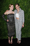 Actresses Julianne Moore (left) and Kristen Stewart arrive at the MoMa Film Benefit Tribute to Julianna Moore presented by Chanel, at the Musuem of Modern Art in New York City, on November 13, 2017.