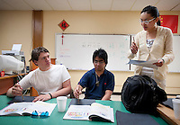 "Yue Zheng (cq, right), instructs sophomores Desmond See (cq, middle), and Timothy Wilkerson (cq, left) how to properly hold a calligraphy brush during a Chinese 1 class at Macarthur High School in Lawton, Oklahoma, April 29, 2010. Zheng is teaching in the US as part of a ""guest teacher"" program for two years...PHOTO/ MATT NAGER"