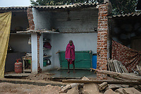 A woman stands inside a broken house in village Gorikothapally, Telangana, Indiia, on Friday, February 8, 2019. Photographer: Suzanne Lee for Safe Water Network