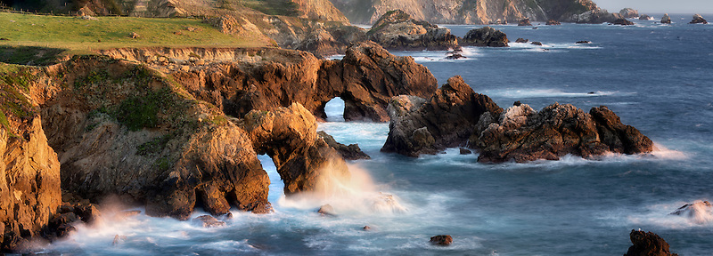 Panorama of arches and waves on Big Sur coast, California