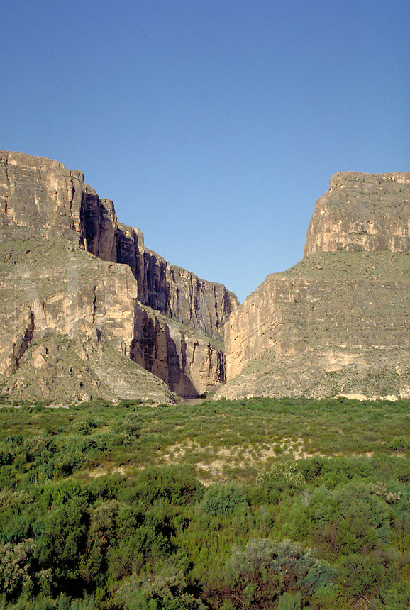 Santa Elena canyon where Rio Grande River passes through rock wall. On left is Mexicos' Sierra Ponce; On the right is Texas' Mesa de Anguila. Texas, Big Bend National Park.