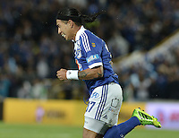 BOGOTÁ -COLOMBIA, 25-08-2013. Dayro Moreno de Millonarios celebra un gol en contra de Pasto durante partido válido por la sexta fecha de la Liga Postobón 2013-1 jugado en el estadio el Campín de la ciudad de Bogotá./ Dayro Moreno of Millonarios celebrates a goal  against Pasto during match valid for the 6th date of the Postobon League II 2013 played at El Campin stadium in Bogotá city. Photo: VizzorImage/Gabriel Aponte/STR