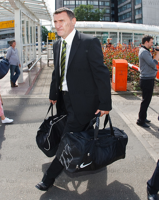 Celtic manager Tony Mowbray leads his squad into Glasgow Airport
