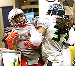 SIOUX FALLS, SD - MAY 4:  Tavron Harrison #22 from the Sioux Falls Storm scores a touchdown while being pushed to the boards by Maurice Simpkins #33 from the Nebraska Danger in the first quarter of their game Saturday night at the Sioux Falls Arena. (Photo by Dave Eggen/Inertia)