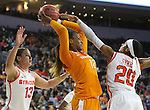 SIOUX FALLS, SD - MARCH 27, 2016 -- Bashaara Graves #12 of Tennessee grabs a rebound between Brianna Butler #13 and Brittney Sykes #20 of Syracuse during their NCAA DI Regional Championship game Sunday at the Denny Sanford Premier Center in Sioux Falls, S.D.  Syracuse won 89-67 to advance to the Final Four and will face Washington. (Photo by Dick Carlson/Inertia)