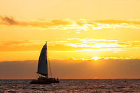 Sunset and a sailboat of the Napali Coast of the Hawaiian Island of Kauai