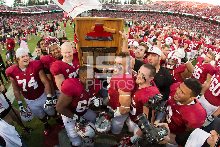 Stanford, CA -- November 23, 2013:  Stanford players with the Axe after defeating Cal 63-13 at Stanford Stadium.