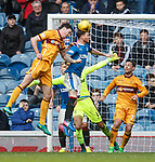 Joe Garner back defending as he clears the ball in the last minute