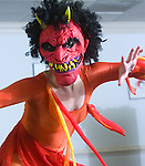 A dancer performs wearing a mask in a practice for The Legend of Sleepy Hollow by the Ballet Theatre of Maryland.
