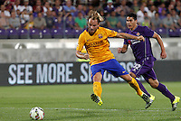 Calcio: amichevole Fiorentina vs Barcellona. Firenze, stadio Artemio Franchi, 2 agosto 2015.<br /> FC Barcelona's Ivan Rakitic, left, kicks the ball past Fiorentina's Facundo Roncaglia during the friendly match between Fiorentina and FC Barcelona at Florence's Artemio Franchi stadium, 2 August 2015.<br /> UPDATE IMAGES PRESS/Riccardo De Luca