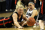 03/10/11--Oregon City's Jordy Klebaum and Tigard's Lexi Carter battle for a loose ball during the quarterfinals of girls 6A championship at the Rose Garden in Portland, Or. The Pioneers advanced to the semifinals with a score of 66-36..Photo by Jaime Valdez........................................
