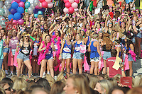 NWA Democrat-Gazette/MICHAEL WOODS &bull; @NWAMICHAELW<br /> University of Arkansas students Saturday August 22, 2015, during Bid Day at the Chi Omega Greek Theater at the University of Arkansas in Fayetteville. &ldquo;Bid Day is an exciting time for the Greek Community as thousands of U of A sorority members gather to extend bids to the new members to join their chapters,&rdquo; said Alexandra Chunn, panhellenic council president.  Bid Day was broadcast live by UATV and the production company Avad3 and simulcast into the Hillside Auditorium near the Greek Theatre.  National Panhellenic Conference, one of the largest organizations advocating for women, is the umbrella group for 26 national and international sororities.  &ldquo;The most important aspect of Bid Day is watching new members open their envelopes which reveals the chapter that has extended them a membership bid,&rdquo; Chunn said. &ldquo;Later, each chapter leads their new members back to the chapter house or other set locations to welcome them into sisterhood.&rdquo;