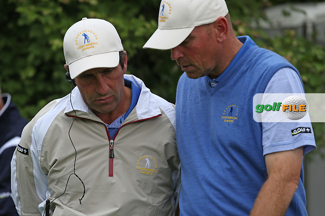 Team Continental Europe Captain Jose Maria Olazabal gives comfort to defeated Thomas Bjorn (DEN) as GB&I win the first match during the Fourball Matches on Day One at the Seve Trophy by Golf+ 2013, from Saint-Nom-La-Breteche, Paris, France. Picture:  David Lloyd / www.golffile.ie