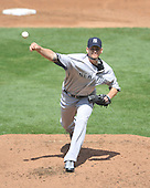 Baltimore, MD - April 9, 2009 -- New York Yankee pitcher A.J. Burnett (34) pitches in the third inning against the Baltimore Orioles at Oriole Park at Camden Yards in Baltimore, MD on Thursday, April 9, 2009..Credit: Ron Sachs / CNP.(RESTRICTION: NO New York or New Jersey Newspapers or newspapers within a 75 mile radius of New York City)
