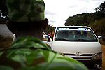 National Park guard stopping vehicle to look for illegal  bushmeat, Lope National Park, Gabon
