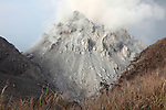 Rerombola lava dome of Paluweh Volcano during ash venting phase of 2012 Eruption, Flores, Indonesia.