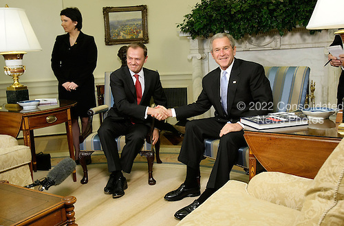 Washington, DC - March 10, 2008 -- United States President George W. Bush (R) shakes hands with Polish Prime Minister Donald Tusk (L) during a meeting at the Oval Office of the White House March 10, 2008 in Washington, DC. Tusk is in Washington to discuss with Bush on the inclusion of Poland in a U.S. build missile defense system.  (Photo by Alex Wong/Getty Images) .Credit: Alex Wong / Pool via CNP