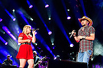 Jason Aldean performs with Kelly Clarkson at LP Field during Day 3 of the 2013 CMA Music Festival in Nashville, Tennessee.