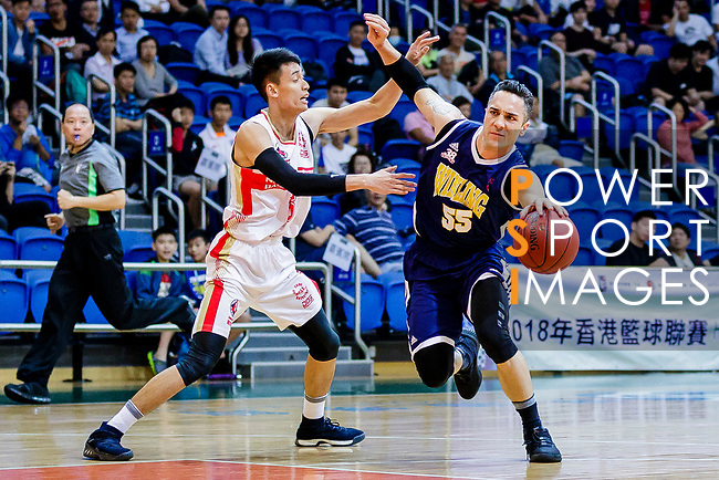 Kepkey Tyler Alexander #55 of Winling Basketball Club dribbles the ball up court against Ng Ka Hin #15 of Nam Ching Basketball Team during the Hong Kong Basketball League game between Nam Ching vs Winling at Southorn Stadium on May 11, 2018 in Hong Kong. Photo by Yu Chun Christopher Wong / Power Sport Images