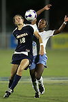 9 November 2007: Virginia's Alex Singer (19) maintains position between the ball and North Carolina's Nikki Washington (26). The University of North Carolina tied the University of Virginia 1-1 at the Disney Wide World of Sports complex in Orlando, FL in an Atlantic Coast Conference tournament semifinal match.  UNC advanced to the finals on penalty kicks, 4-2.