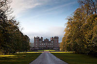 A romantic prospect of Drumlanrig Castle in sweeping parkland, with its baroque turrets and colonnade