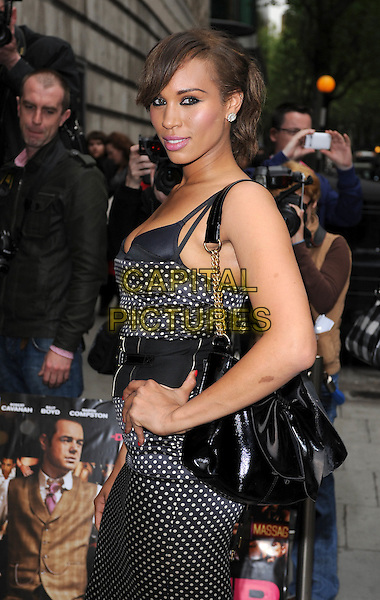 "JAVINE HYLTON.The premiere of ""Pimp"", Odeon Covent Garden, London, England. .19th May 2010.half length black white polka dot dress hand on hip bra bustier chain strap bag waist belt .CAP/BEL.©Tom Belcher/Capital Pictures."