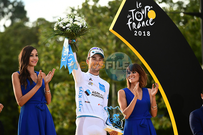 Pierre Latour (FRA) AG2R La Mondiale wins the young riders White Jersey, on the podium at the end of Stage 21 of the 2018 Tour de France running 116km from Houilles to Paris Champs-Elysees, France. 29th July 2018. <br /> Picture: ASO/Alex Broadway | Cyclefile<br /> All photos usage must carry mandatory copyright credit (© Cyclefile | ASO/Alex Broadway)