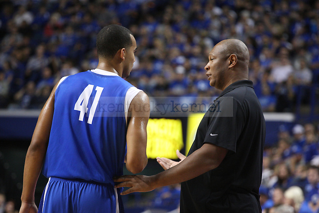 Assistant coach Kenny Payne speaks with forward Trey Lyles during the first half of the Blue-White Scrimmage at Rupp Arena on Monday, October 27, 2014 in Lexington, Ky. Photo by Adam Pennavaria | Staff