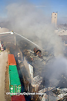 63818-02405 Firefighters extinguishing warehouse fire using aerial ladder truck viewed from top of ladder, Salem, IL